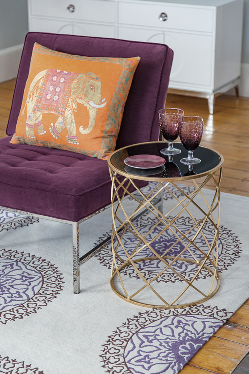 Purple Velvet Chair, Orange Elephant Pillow, and Black Glass amp Metal Side Table